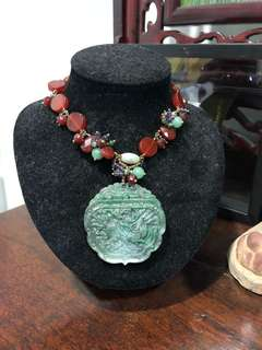 Green jade double sided  carved kirin and Chinese word 福 pendant