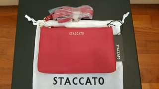 Staccato mini clutch / sling bag