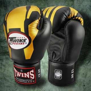 Twins Special Muay Thai Gloves 'Iron Man' Black/Gold – 12 oz