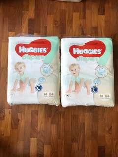2 unopened Huggies Platinum Diapers (M)
