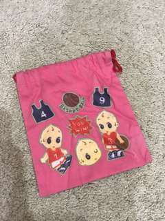 Small pink drawstring pouch