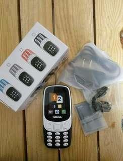Basic keypad phone with load retailer