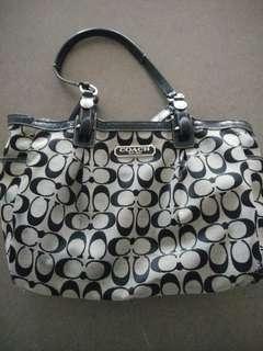 EST. Coach black and gray purse