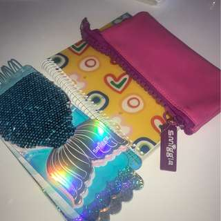 2 Smiggle pencil case, and one notebook