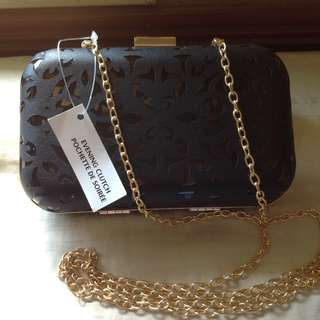 Evening clutch bag with chain