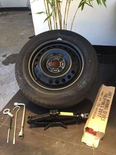 Spare tire with Honda Jack, early warning device and tools