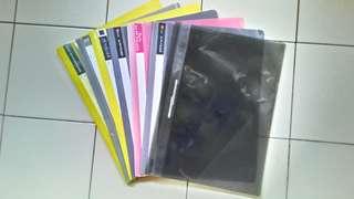 7 Assorted plastic folders