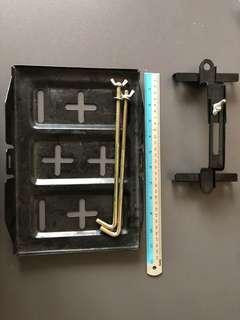 Automotive battery relocation tray/holder