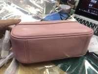 Coach粉紅色斜背包