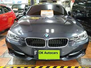 Mobil BMW 320i Sport 2.0 Abu abu matic plat F