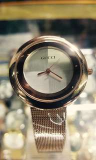 Round face gold watch