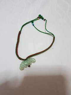Tie string bracelet with jade element