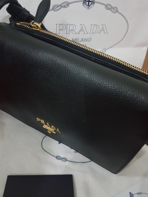 5e37ca57a52 Prada Vitello Daino Leather Crossbody Sling Bag, Luxury, Bags & Wallets on  Carousell