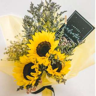 Sunflower bouquet with assorted flowers