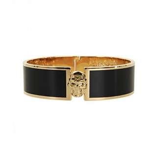 Alexander McQueen enamel cuff with skull logo