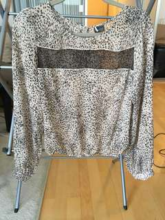 Leopard print blouse with open back