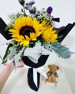 Black and white wrapped double giant sunflower bouquet
