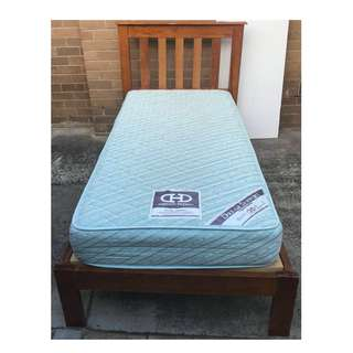 Excellent wooden single bed frame with blue mattress. Delivery