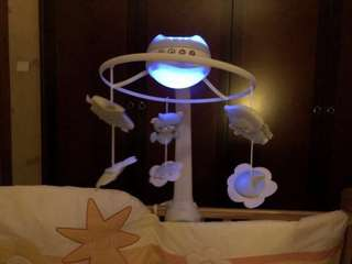 Infantino baby bed rotating newborn toys lights
