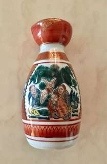 Japanese Kutani sake bottle painted with traditional human & flower pattern