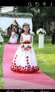 White gown with red petals