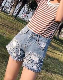 Foreign trade women's 2018 stylish heavy beaded hole denim shorts washed flashing hot pants