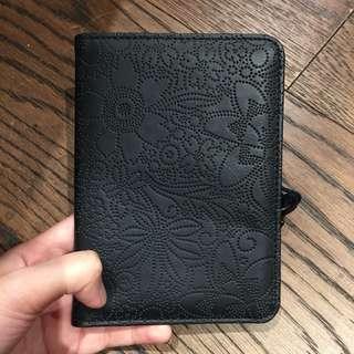 Typo passport holder