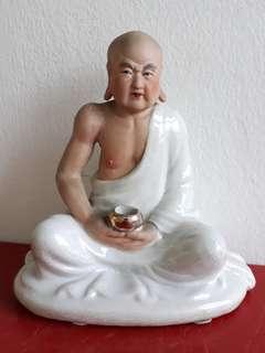 Old Porcelain Statued
