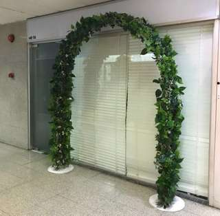 Wedding arch covered with leaves for rent