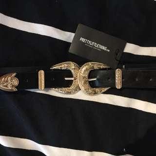Gold double buckle western belt