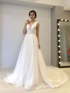 Deep V cut sleeveless wedding dress