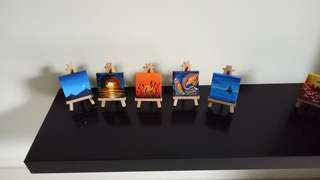 Miniature acrylic painting with esel