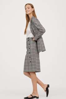Grey checked knee length button down skirt