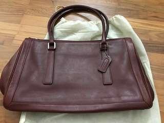 A Beautifully kept Coach Maroon Handbag