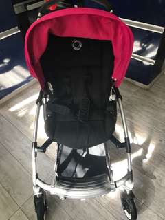 Bugaboo Bee Plus with pink and orange canopy