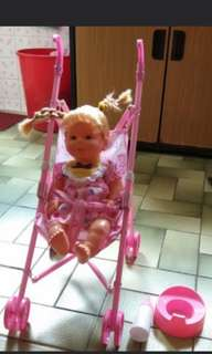 Doll with stroller