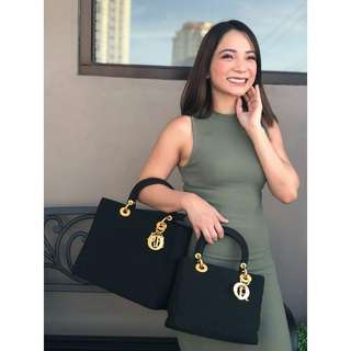 Excellent condition. Authentic Lady Dior Small Black canvas/ Gold hardware. Made in Italy.