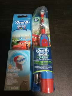 Oral b power stage electric toothbrush with two free brush heads