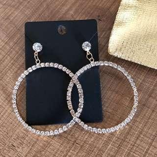 Elegant loop earrings with faux diamonds
