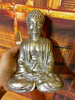 Silver sakyamuni buddha