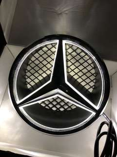 Benz logo with light