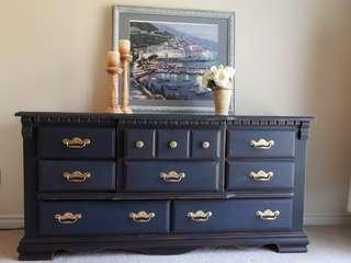 Dark blue solid wood dresser.