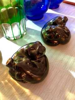 2 small black pigs sculptures. Heavy fiberglass.