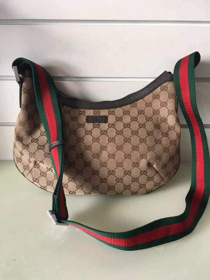 a1999de6e470b4 Gucci Monogram Trim Half Moon Handbag Canvas and Leather Crossbody Bag on  Carousell
