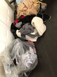 A garbage bag filled of clothes