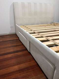 Queen bed frame with four storage drawers