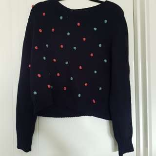 Navy knitted top with pom poms