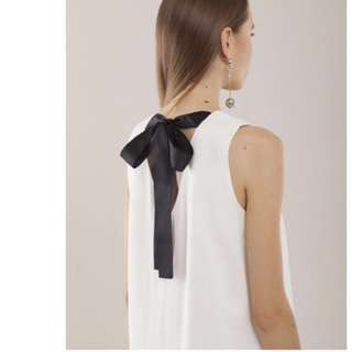 White dress with big ribbon details