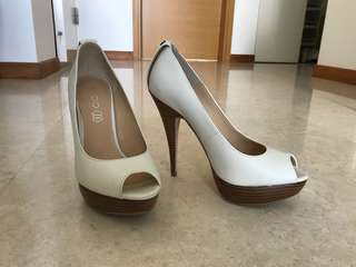 White elegant leather pumps