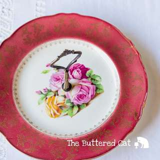 Bold and beautiful vintage Royal Winton cake plate, maroon red border, pink roses